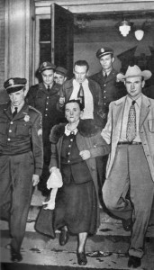 Betty Burge and her son, Sherman, being led away after their conviction for murder.