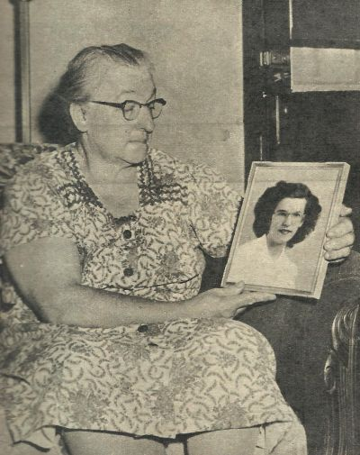 Mother Lucy Hatch with a photograph of her missing daughter, Doris.