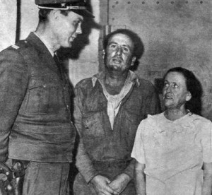 Sherman and Betty Burge under arrest.
